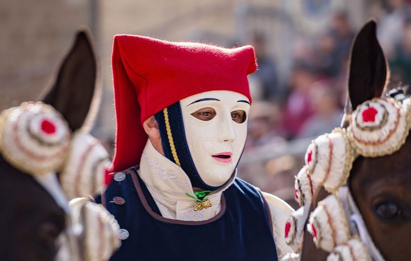 Close-up of traditional mask against trees during festival