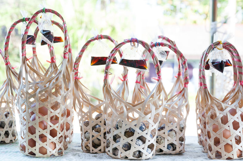 Group Wicker round bamboo basket for quail eggs at local market in Thailand Quail Eggs Quail's Eggs Wicker Bamboo Basket Bracelet Celebration Choice Christmas Decoration Eggs Eggs For Breakfast Event Gold Holiday Jewelry No People Pattern Personal Accessory Quail Quail Egg Still Life Table Variation Wicker Basket