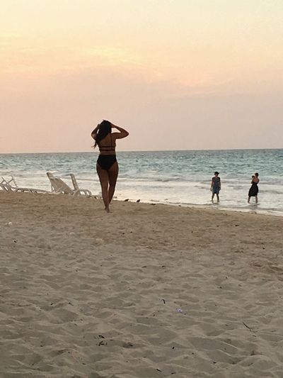 Evening swim. Beach Real People Horizon Over Water Shore Sea Sand Sunset Sky Women Beauty In Nature Lifestyles Water Outdoors Wave Day
