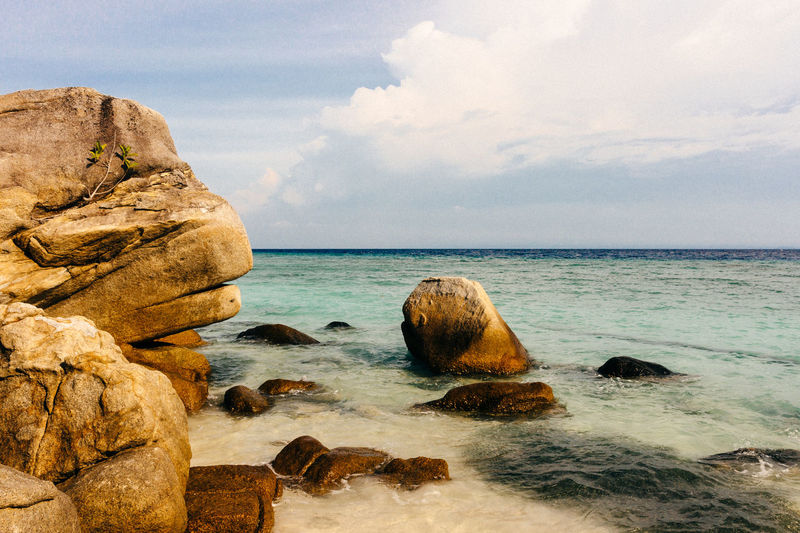 Beach Life Relaxing Sunlight Vacations Beach Beach Day Beauty In Nature Horizon Horizon Over Water Landscape Nature No People Outdoors Rock Rock - Object Rock Formation Scenics - Nature Sea Sea And Sky Seascape Sky Stack Rock Tourism Tranquil Scene Water
