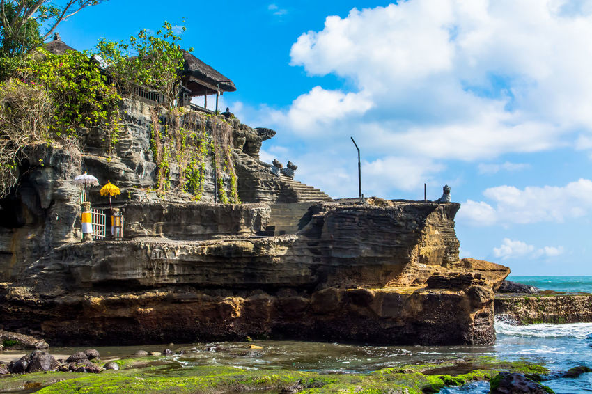 Ancient Architecture Bali, Indonesia Balinese Culture Building Exterior Built Structure Cloud - Sky Cultures Day History Horizontal Low Tide No People Outdoors Place Of Worship Religion Sea And Sky Sea Temple Sky Spirituality Tanah Lot Bali, Indonesia Temple Travel Travel Destinations Tree