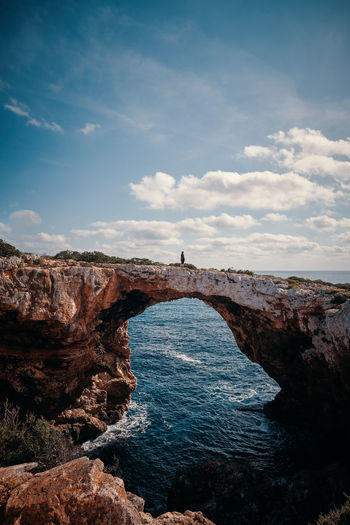 Mallorca Beauty In Nature Cliff Cloud - Sky Day Geology Horizon Over Water Idyllic Lighthouse Natural Arch Nature No People Non-urban Scene Outdoors Physical Geography Rock - Object Rock Formation Scenics Sea Sky Tranquil Scene Tranquility Travel Destinations Water