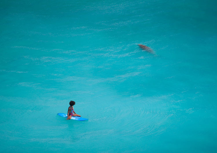 High Angle View Of Woman Surfing In Sea