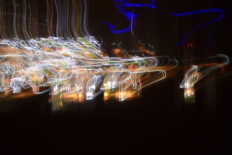 Illuminated light trails in city at night