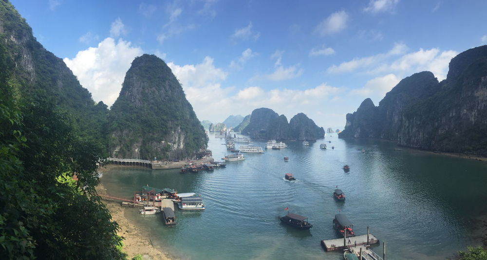 Ha Long Bay Ha Long Bay Beauty In Nature Cloud - Sky Day Ha Long Bay Ha Long Bay Cruise Incidental People Mode Of Transportation Mountain Mountain Range Nature Nautical Vessel Outdoors Passenger Craft Plant Scenics - Nature Sea Sky Tranquil Scene Tranquility Transportation Travel Tree Water