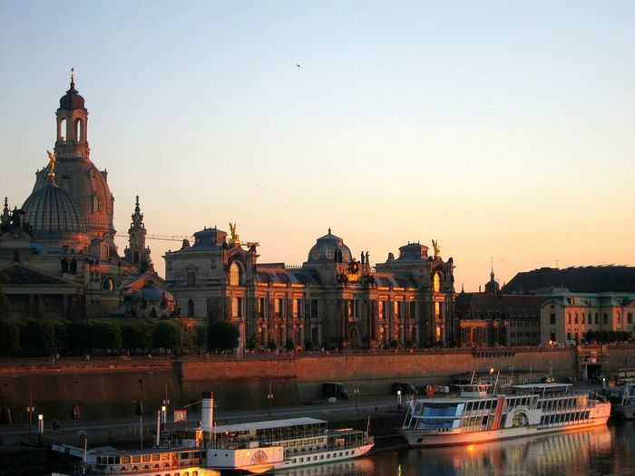 Boats In Canal By Dresden Frauenkirche Against Sky During Sunset