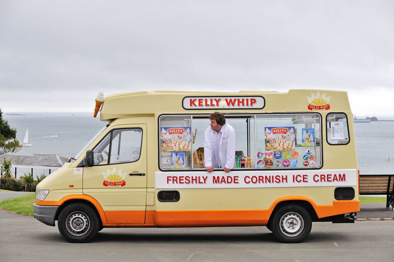 Ice cream van and vendor waiting for sales English Seaside Seaside Exploring Day England English Ice Cream Van Men Occupation Outdoors People Real People Sky Standing