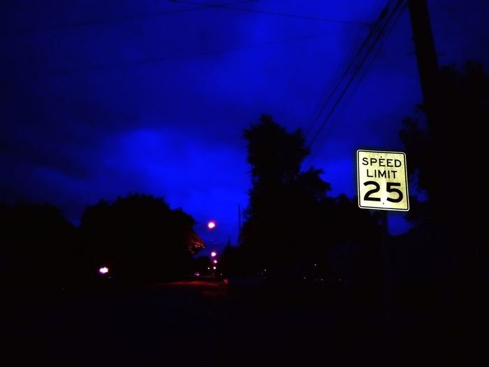 At Night Speed Limit Sign Night Night Sky Dark Shadow Shadows Light Distant Light Illuminated Illuminated Road Sign Tree Blue Communication Guidance Neon Text Sky Architecture Directional Sign Information Sign Signboard Sign