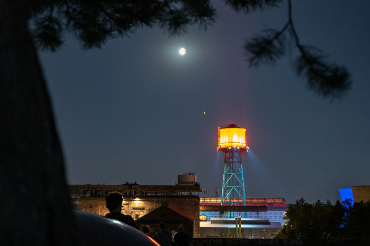Low angle view of water tower against sky at night, totale mondfinsternis, bochum