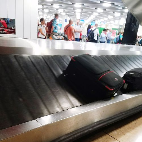 Switzerland Travel Destination Indoors  Baggage Claim Baggage Carousel Bags Suitcase Let's Go. Together.