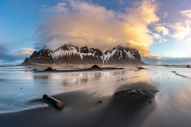Panoramic shot of sea shore against sky during sunset
