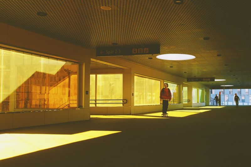Full length of man standing in illuminated building