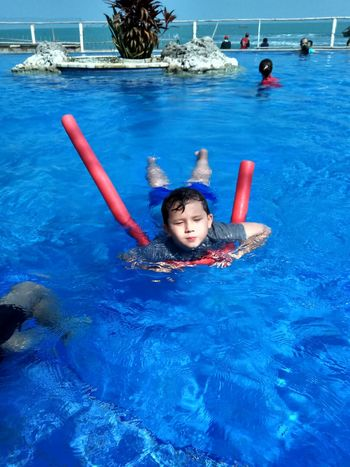 Water Swimming Swimming Pool Portrait Child Looking At Camera Floating On Water Fun Happiness Enjoyment