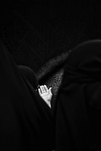 Rear view of people praying