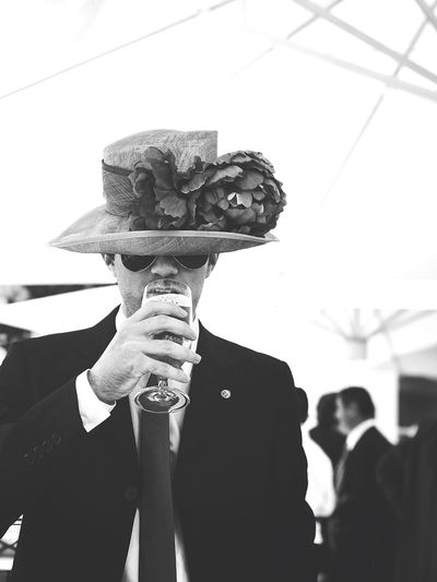 Young Man Drinking Beer During Wedding