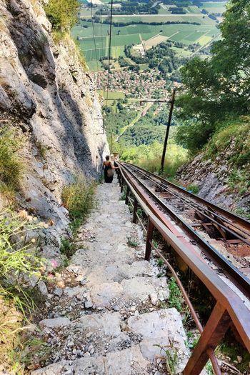 Railroad track amidst rocks
