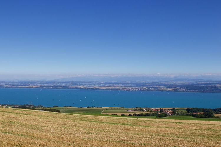 Scenic view of lake geneva against clear sky