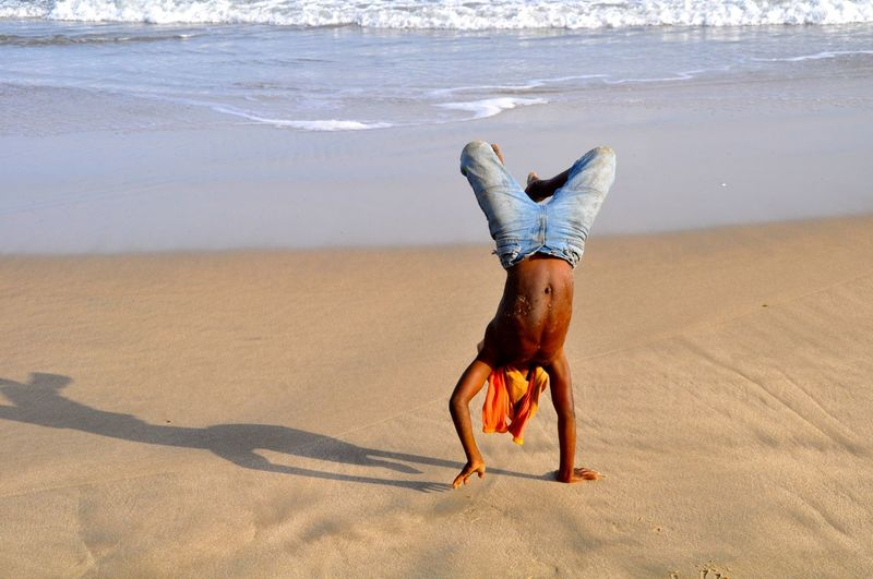Joy of Life African Beach Beach Photography Casual Clothing Coastline Happiness Happy Headstand Joy Joy Of Life Man Outdoors Sand Sea Shore Summer Sunny Feel The Journey Inner Power