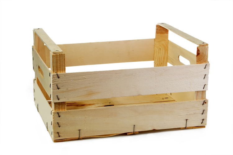 Close-up of wooden crate on white background