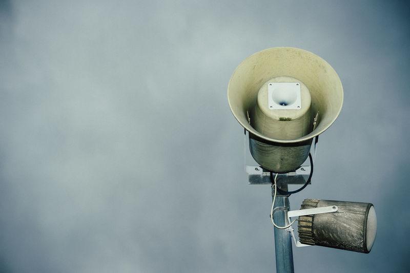 Close-up of megaphone against sky