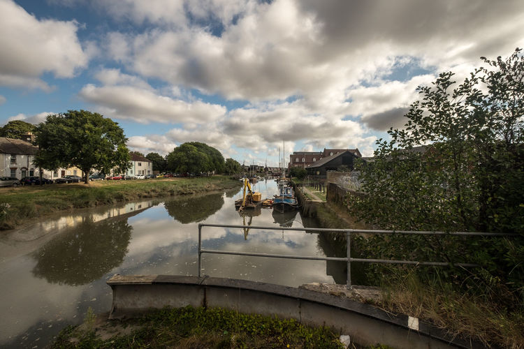 Faversham river Architecture Bridge Bridge - Man Made Structure Building Exterior Built Structure Canal Cloud Cloud - Sky Cloudy Day Footbridge Nature Outdoors Park Plant Reflection Scenics Sky Standing Water Tourism Tranquil Scene Tranquility Travel Destinations Tree Water
