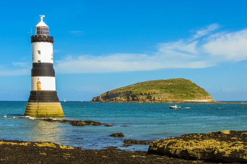 The lighthouse at Penmon point and Puffin Island in Anglesey region (Wales) Anglesey Blue Building Coast Coastline Great Britain Island Lighthouse Llangoed Nature Ocean Outdoors Penmon Penmon Point Puffin Island Scenics Sea Shore Sky Sunny Travel Uk United Kingdom Wales Water