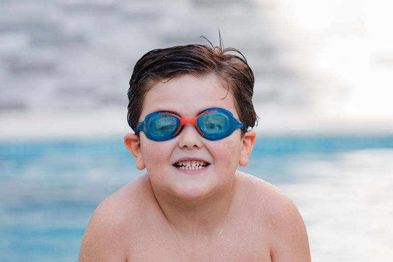 Portrait of smiling boy in swimming pool