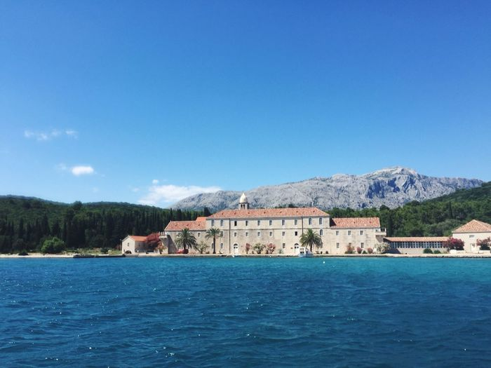 Monastery on a small island off Korcula that's still owned by Bosnians From A Boat Korčula Sailing Nature Island Monastery Croatia Europe Summer Blue Sea And Clear Water