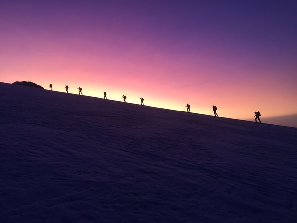 Sunrise Ridge Walkers Mountaineering Purple Sky Mountain View Colourful Sunrise Mountain Silhouette Beauty In Nature Nature Scenics Tranquil Scene Lifestyles Landscape Leisure Activity Walking Shades Of Winter Go Higher