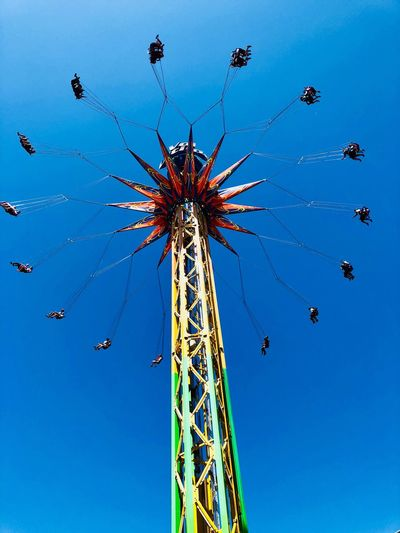 La Ronde EyeEm Selects Low Angle View Sky Clear Sky Arts Culture And Entertainment Blue Nature Tall - High Built Structure Amusement Park Architecture No People Outdoors Chain Swing Ride Celebration Enjoyment Amusement Park Ride Tree Day Motion Excitement