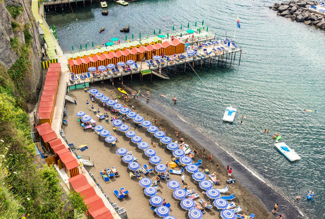 Enjoying the beach at Sorrento Day Elevated View High Angle View Leisure Activity Lifestyles Nature Outdoors Shore Sorrento, Italia Tourism Tranquility Umbrellas Vacations Water Original Experiences