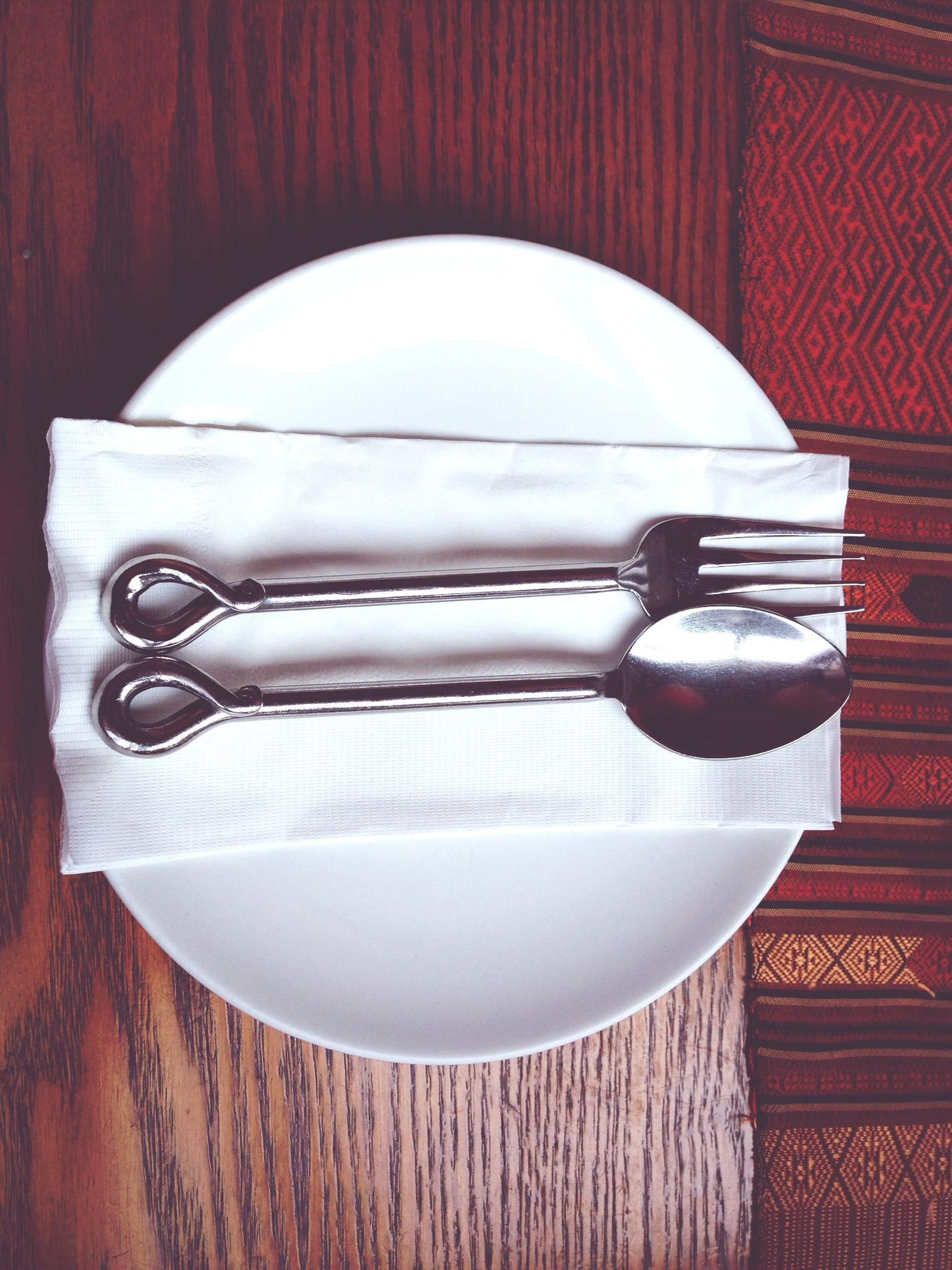 indoors, still life, table, close-up, high angle view, spoon, fork, directly above, food and drink, no people, white color, wood - material, studio shot, single object, variation, two objects, table knife, metal, man made object, plate