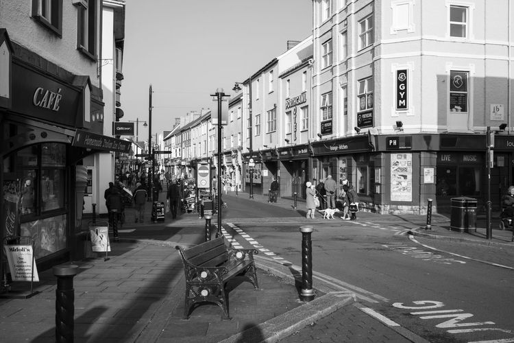 Street View Architecture Black And White Building Exterior Built Structure Cafe City City Life Coastal Town Day Large Group Of People Men Monochrome Outdoors People Real People Road Road Junction Sky Street Transportation