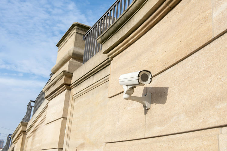 Low Angle View Of Cctv Camera On Building