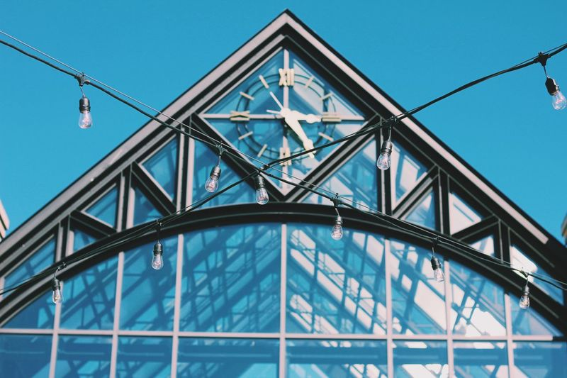 EyeEmNewHere Fairylights Lights Architecture Built Structure Connection Triangle Shape Metal Low Angle View Day Outdoors Sky Blue Clear Sky