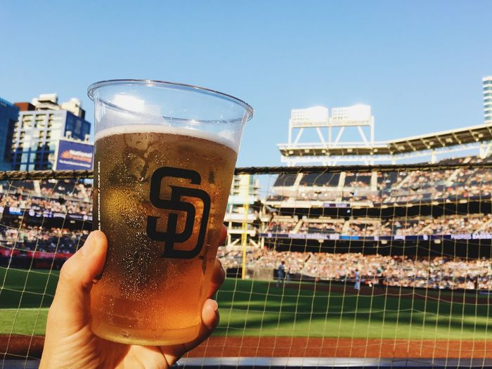 Baseball pairs well with local craft beer. Cheers! Refreshment Drink Food And Drink Real People Sky Human Hand Love The Game Beer - Alcohol Glass Lifestyles Day One Person Alcohol Beer Architecture Holding Human Body Part Hand Built Structure Beer Glass Nature