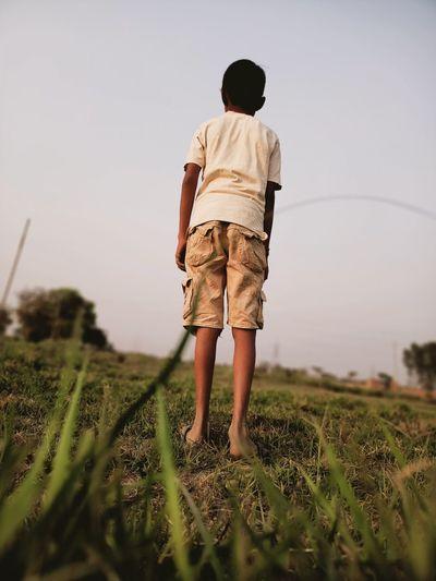 Boy stand in golf practice club