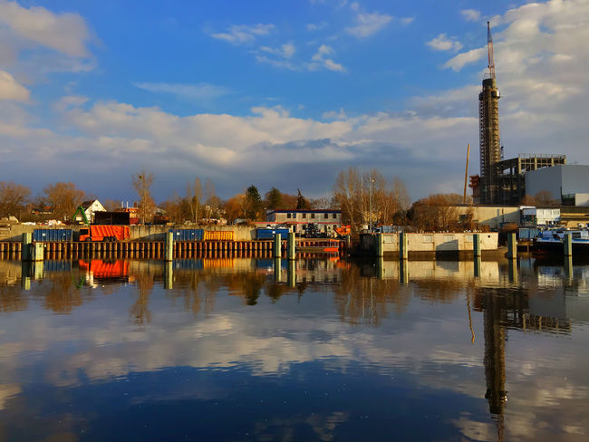 scrap yard near a canal Garbage Truck Canal Chimney Clouds Clouds And Sky Container Containers Garbage Junk Nautical Vessel Outdoors Pier Reflection Refuse Collection Vehicle Refuse Collector Scrap Scrap Metal Scrap Yard Scrapyard Sky Smokestack Stack Waste Water Waterfront