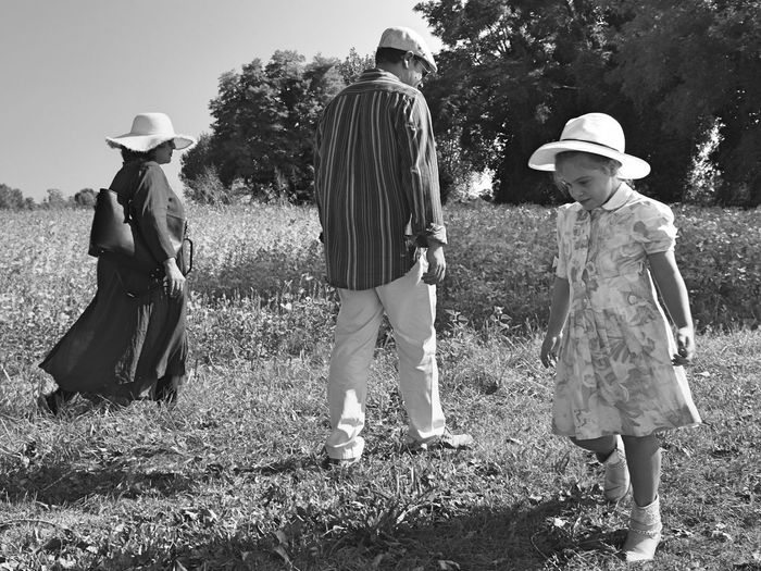 Full Length Tree Togetherness Casual Clothing Rear View Bonding Childhood Grass Girls Field Day Innocence Casual Blackandwhite Black And White Tranquil Scene Portraits Nature Family Family With One Child Tranquility