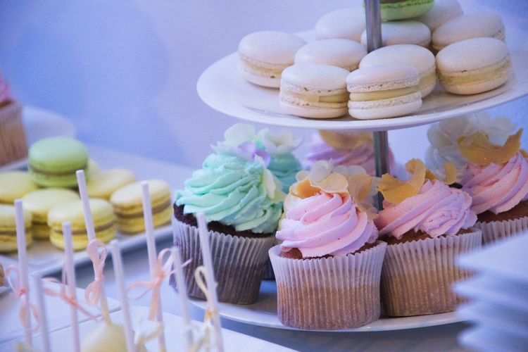 Close-up of cupcakes and macaroons in stand