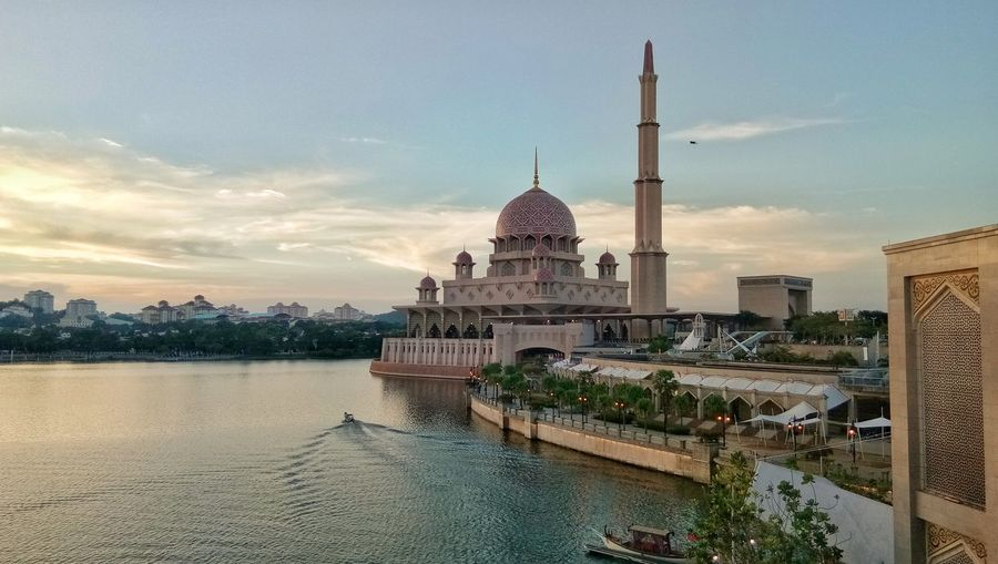 Putra mosque during sunset Islamic Architecture Dome Lake View Minaret Putra Mosque Floating On Water Tourist Attraction  Touristic Destination Dome Place Of Worship City Religion Sky Architecture Mosque