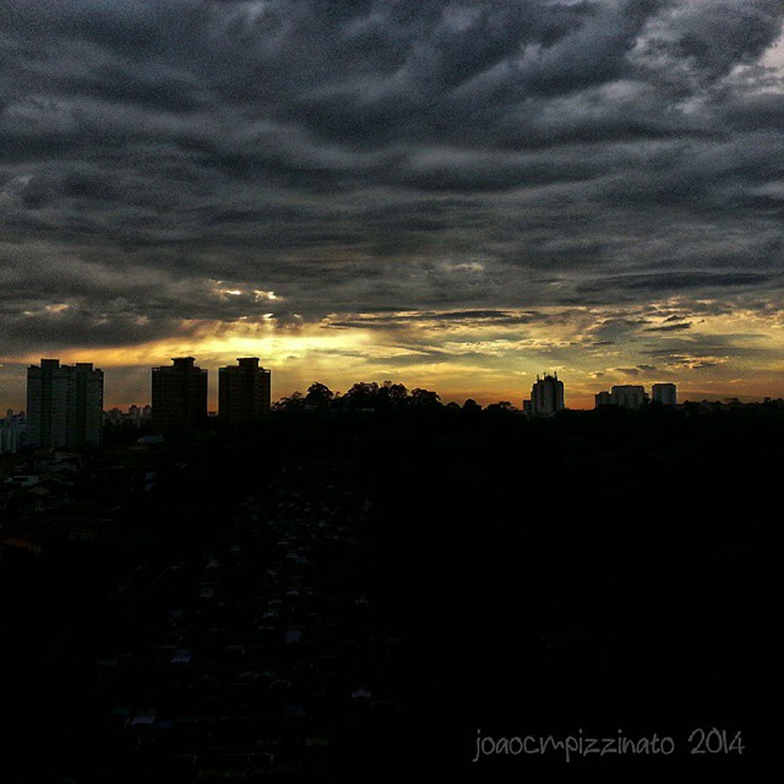 sunset, silhouette, building exterior, sky, architecture, built structure, city, cloud - sky, cityscape, cloudy, dramatic sky, dusk, dark, cloud, scenics, urban skyline, skyscraper, orange color, residential building, weather