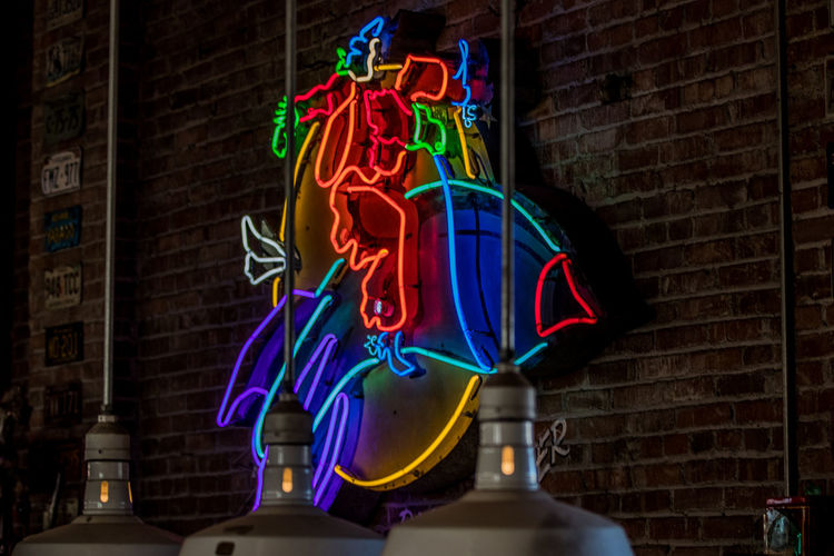 Illuminated Brick Wall No People Architecture Wall Motion Brick Multi Colored Low Angle View Representation Building Exterior Creativity Hanging Built Structure Glowing Lighting Equipment Wall - Building Feature Neon Variation