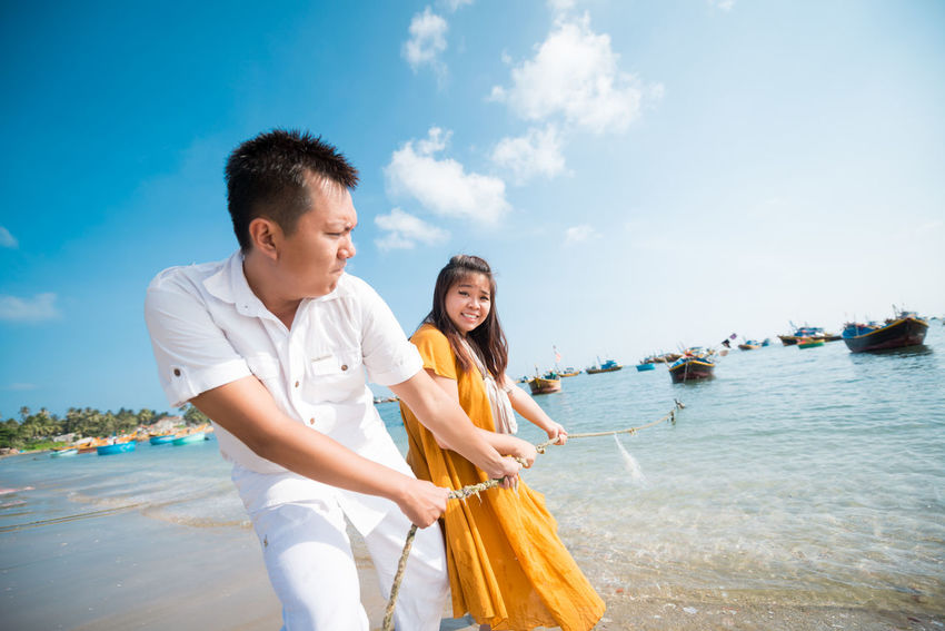 Cheerful Child Close To Enjoyment Happiness Leisure Activity Lifestyles Luxury Relaxation Sea Sky Smiling Summer Togetherness Tourism Tourist Travel Travel Destinations Vacations Wealth Weekend Activities Women Young Adult Young Men Young Women