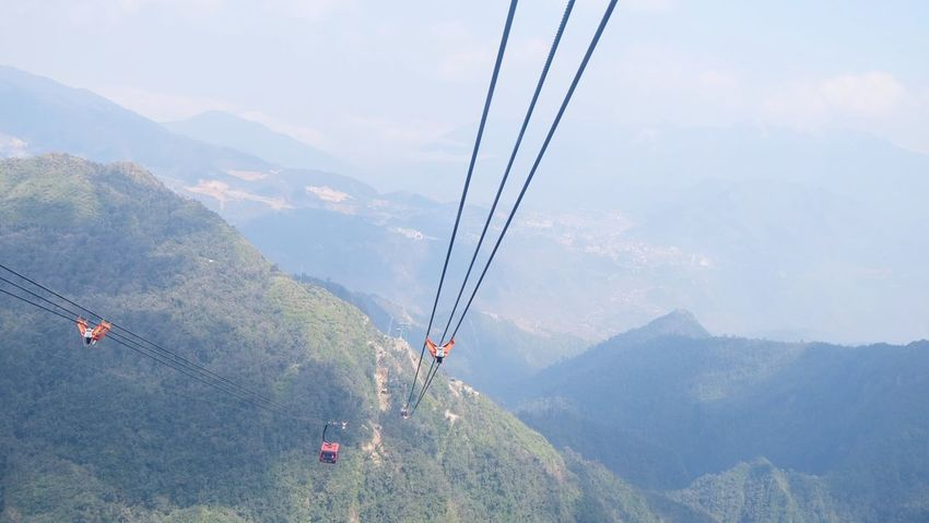 Mountain Cable Fog Mountain Range Overhead Cable Car Nature Scenics Outdoors Day Landscape Ski Lift Mountain Peak Cloud - Sky No People Sky Electricity  Beauty In Nature Tree Beauty Tea Crop Fansipan Sapa, Vietnam
