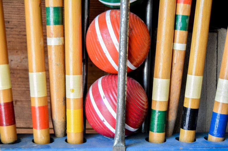 Backyard Fun Croquet Games Fun Lawn Back Yard Equipment Old Worn Color Orange Red Closeup Close-up Sam Kratzer