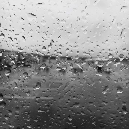In the rain Transparent Drop Water Wet Window Backgrounds No People Close-up RainDrop Day Nature Sky Freshness First Eyeem Photo