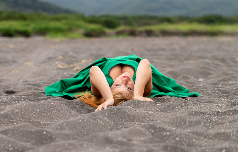 One Person Lying Down Real People Full Length Leisure Activity Lifestyles Relaxation Green Color Nature Portrait Day Young Adult Front View Land Clothing Child Childhood Outdoors Teenager
