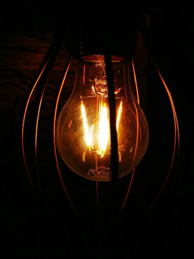 Electricity  Lighting Equipment Illuminated Light Bulb Glowing Filament Technology Close-up Hanging No People Indoors  Modern Retro Retro Styled Filament Light Filament Bulb Filaments Light And Shadow Glowing In The Dark Glowing Lights Backgrounds Full Frame Wallpaper For Mobile EyeEmNewHere Welcome To Black
