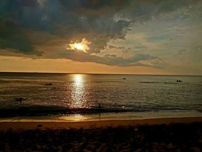 Sunset Sky from Beach infront of Lanta Palace Resort, Koh Lanta, South Thailand. ... Water Sea Sunset Beach Sand Reflection Sky Horizon Over Water Cloud - Sky Low Tide Coastal Feature Sun Coastline Ocean Tide Seascape Calm Silhouette Idyllic